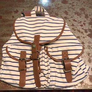Striped backpack with leather straps